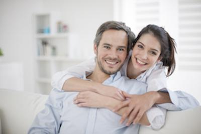 Couple on couch | Dental implants castle rock co