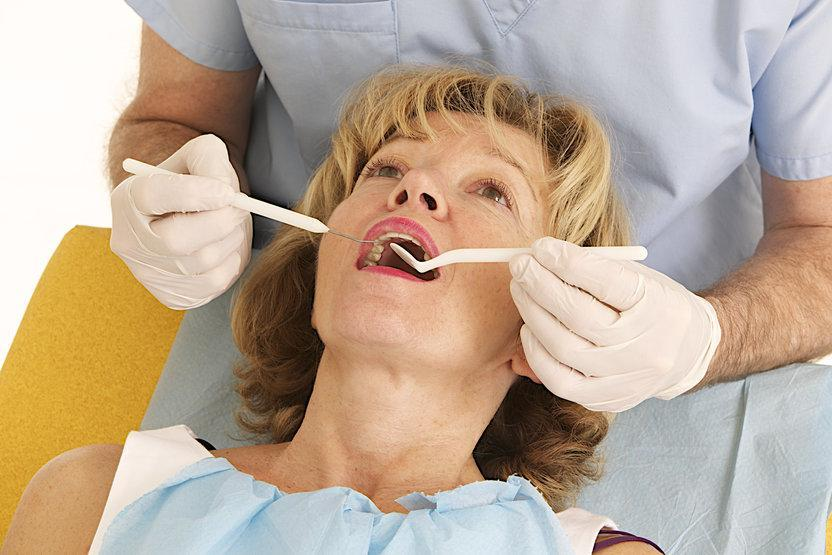 woman getting dental check in castle rock