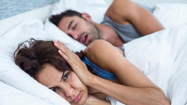 Woman holding ears because of snoring spouse | Dentist Castle Rock CO