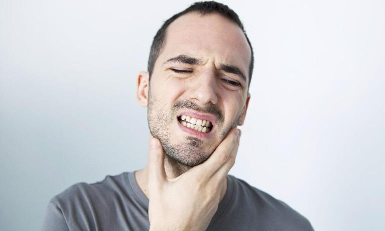 Man holding jaw in pain | Dentist Castle Rock CO